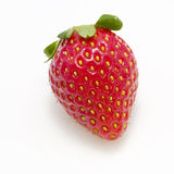 Strawberry. A red strawberry, isolated on a white background Royalty Free Stock Image