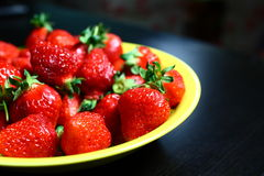 Strawberry. Red strawberry on the yellow plate Stock Photo