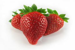 Strawberry. Three strawberries closeup on white background Royalty Free Stock Images