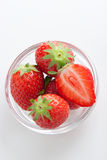 Strawberry. Group of ripe fresh strawberries in glass bowl isolated on white Stock Photos