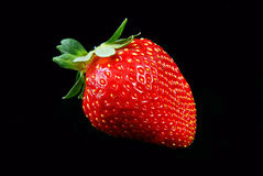 Strawberry. One strawberry isolated on a black background Royalty Free Stock Photo