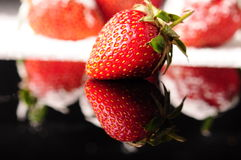 Strawberry. Delicious strawberry on black background Royalty Free Stock Photography
