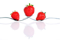 Strawberry. On a fork isolated on white background stock photography