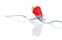 Strawberry. On a fork isolated on white background Royalty Free Stock Images