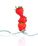 Strawberry. On a fork isolated on white background stock images