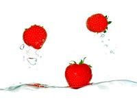 Strawberry. Splash isolated on white background Royalty Free Stock Photos