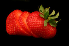 Strawberry. On black background Royalty Free Stock Images