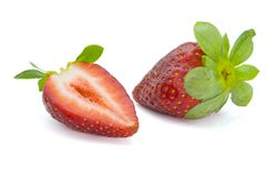 Strawberry. Cut on half and isolated on white Royalty Free Stock Images