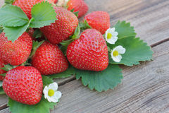 Strawberry. Closeup of strawberry on wooden board Royalty Free Stock Photo