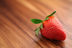 Strawberry. Close-up of strawberry on wood Royalty Free Stock Images
