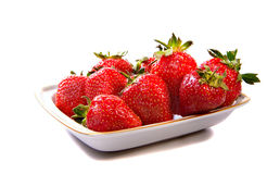 Strawberry. On a plate on a white background Stock Images