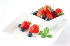 Strawberry. With blueberry in the white bowl Stock Photography