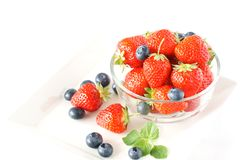Strawberry. With blueberry in the glass bowl Stock Photos