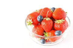 Strawberry. With blueberry in the glass bowl Royalty Free Stock Photos