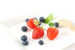 Strawberry. With blueberry on the white plate Stock Photo
