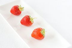 Strawberry. On the white plate Royalty Free Stock Photography