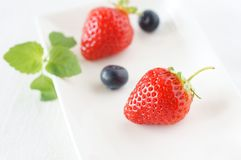 Strawberry. With blueberry on the white plate Royalty Free Stock Photos