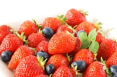Strawberry. With blueberry in the white bowl Stock Image