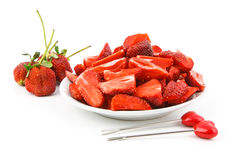 Strawberry. Many pieces of strawberry with heart fork Royalty Free Stock Images