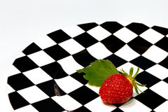Strawberry. On a chess plate Royalty Free Stock Photography