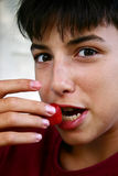 Strawberry. Teen eating strawberry stock image