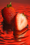 Strawberry #4. Strawberry, water and mirror surface Royalty Free Stock Photography