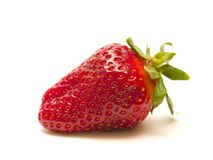 Strawberry. Single strawberry on white background Royalty Free Stock Photography