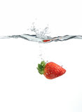 Strawberry. Dropping into water created big splash Royalty Free Stock Images