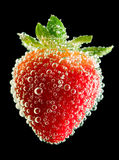 Strawberry. Fresh strawberry with bubbles on black Royalty Free Stock Photos