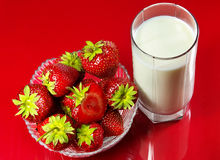 Strawberry. And glass of milk Stock Photo