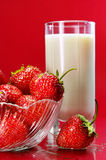 Strawberry. And glass of milk Royalty Free Stock Photos