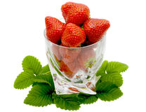 Strawberry. Berry in the glass  and strawberry leaves isolated on a white background Royalty Free Stock Image