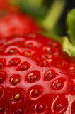 Strawberry. Fresh vivid colored strawberry over black background Royalty Free Stock Photos