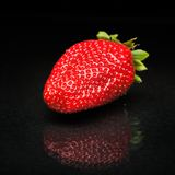 Strawberry against black background. Perfect ripen strawberry against black background stock photos