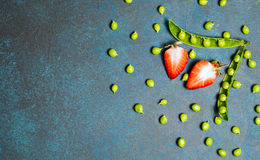 Strawberry amd green peas on vintage eco background. healthy eating concept. Flat lay, top view Royalty Free Stock Image