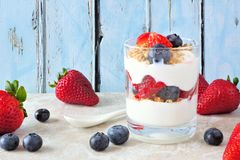 Free Strawberry And Blueberry Parfait Against A Blue Wood Background Stock Images - 152247814