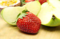Strawberry And Apple. A fresh strawberry with sliced green apples stock photo