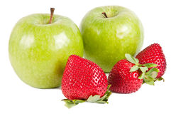 Strawberry and Apple. Three strawberries in front of two green apples Stock Photos