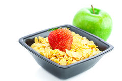 Strawberry,apple and flakes in a bowl Royalty Free Stock Image