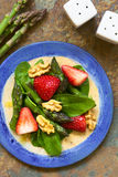 Strawberry, Asparagus, Spinach and Walnut Salad Stock Photos