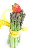 Strawberry, asparagus tied with measuring tape Royalty Free Stock Photos