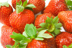 Strawberry background. With green leaves royalty free stock image