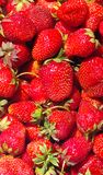 Strawberry.background. Ripe red strawberry close up as background Royalty Free Stock Images