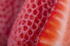 Strawberry Background. Macro close-up of a cut strawberry with soft focus Royalty Free Stock Image