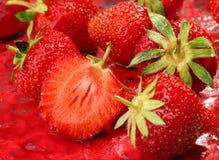 Strawberry background with slice Stock Photos