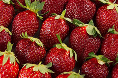 Strawberry background of whole strawberries.  Colorful ripe strawberries. Fruit background. Strawberry pattern. Spring, summer bac Royalty Free Stock Images
