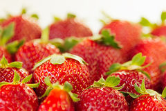 Strawberry background of whole strawberries in sunlight.  Colorful ripe berries  strawberries. Fruit background. Strawberry patter. N. Spring background. Summer Stock Photos
