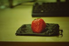 Strawberry on bags. In the office Royalty Free Stock Images
