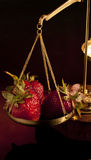 Strawberry on balance scale Royalty Free Stock Photo