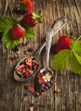 Strawberry Balsamico Herbal Tea. O wooden background royalty free stock photo